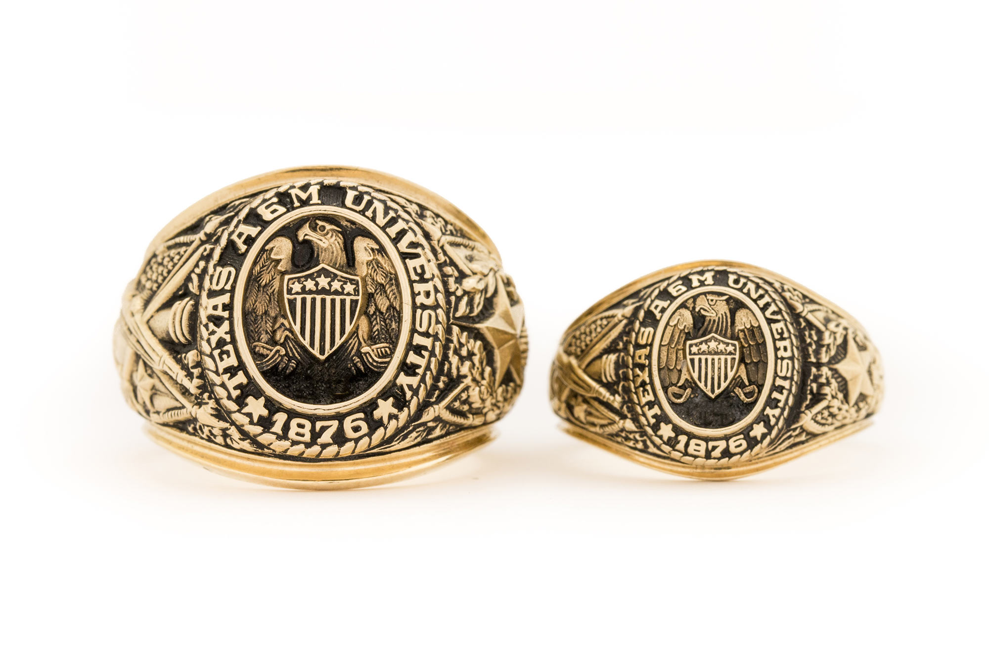 Side by side comparison of large and small Aggie Rings