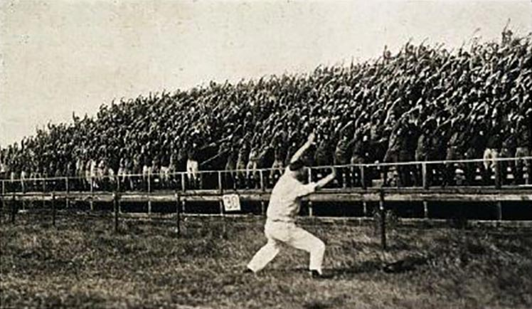 A Yell Leader leading yells in 1920