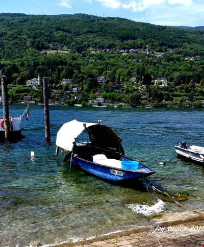 "a traditional ""Lucia"" Fishing Boat ready for the next catch on Lake Maggiore Italy"
