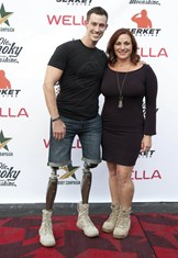Boot Campaign CEO Robyn Payne '94 with veteran Joey Jones