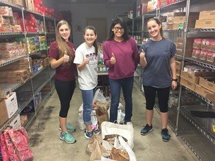 Last week, BCAMC gave the 12th Can pantry the contributions you brought to the Club's Christmas party -- 68 lb of canned goods and $225. That's in addition to the formal donation the Club made earlier that day of $5,000. / Photo by BCAMC finance officer Stephanie McMillen '07