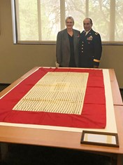 Texas A&M Provost and Executive Vice President Karan Watson and the commandant of A&M's Corps of Cadets, Brig. Gen. Joe E. Ramirez, Jr. '79, receive one of the flag replicas April 6, 2017, at the Texas State Library and Archives Commission in Austin. Photo by Texas A&M University Archivist Greg Bailey.