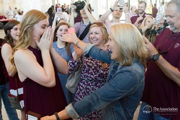 Faith Prasatik '18 was overwhelmed by the moment. To browse hundreds more Ring Day photos, visit tx.ag/April17RingDay