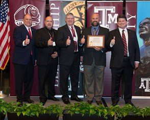 "Association President and CEO Porter S. Garner III '79 (far left) and Association Board Chair Phil Miner '80 (far right) presented the official Tomball Area A&M Club charter to (from left) Rafael ""Rif"" Gonzalez '89, Ron Roberts '90, and Aaron Redding '00."