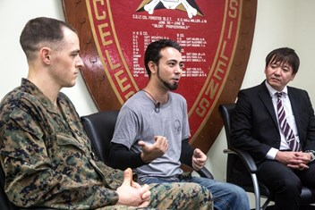 1st Lt. Aaron Cranford speaks in an interview with Justin Kinjo and Yusuke Teruya, divers who almost lost their lives at the hands of a rip current, after he received the Navy and Marine Corps Medal on Jan. 8, 2018, at the 3rd Reconnaissance Battalion Headquarters building on Camp Schwab, Okinawa, Japan. U.S. Marine Corps photo by Lance Cpl. Josue Marquez.