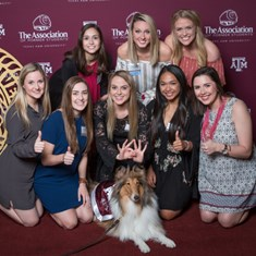A group of Aggie Greeks pose with Reveille at 2017's awards reception.