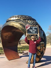 "Jan Weston '18 proudly holds up the ""I Just Ordered my Aggie Ring"" sign after ordering her little piece of Aggie Gold"
