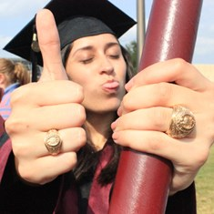 Katherine Martinez Hauser '17 shows off her Aggie Ring along with the Ring her father, Kevin Michael Hauser '90, wore before his death.