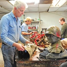 Artist Larry Stevens works on pieces of the statue of James Earl Rudder '32, set to be dedicated in June in Brady, Texas. Photos courtesy of James E. Stewart '92/Brady Standard-Herald