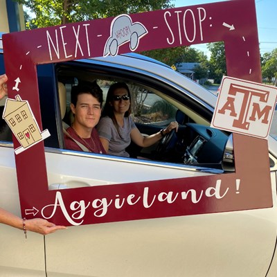 Aggie Moms Hand Out 'Howdys' At Drive-Through Events