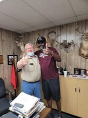 Steve Olfers (left) was able to reunite Anthony Ware '94 with his lost Aggie Ring.